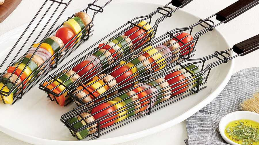 kabob grilling baskets on a serving plate