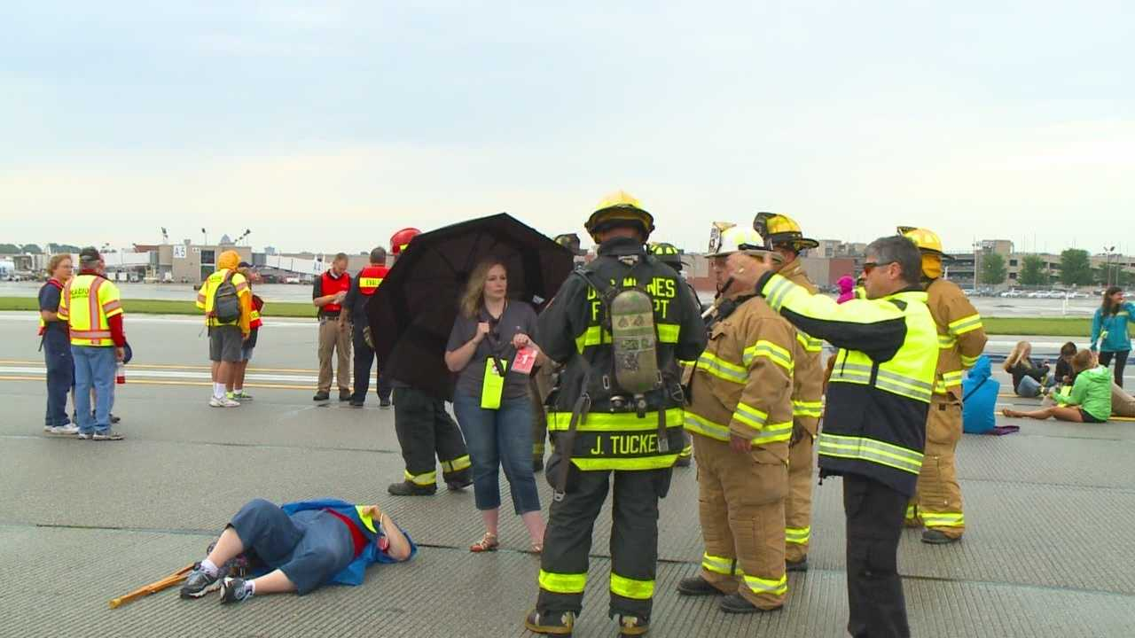 About 70 volunteers acted as injured plane passengers for a full-scale emergency drill.