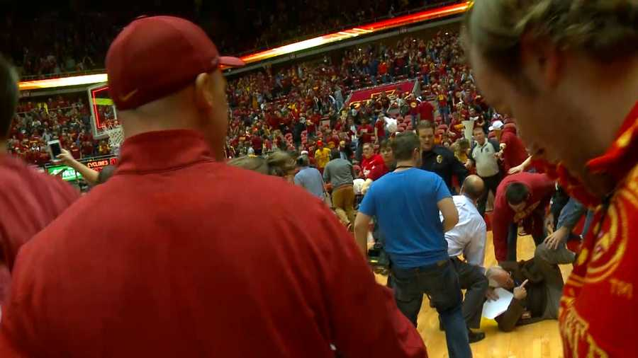 Reporter Randy Peterson hurt during rush onto the court after the Cy-Hawk game.