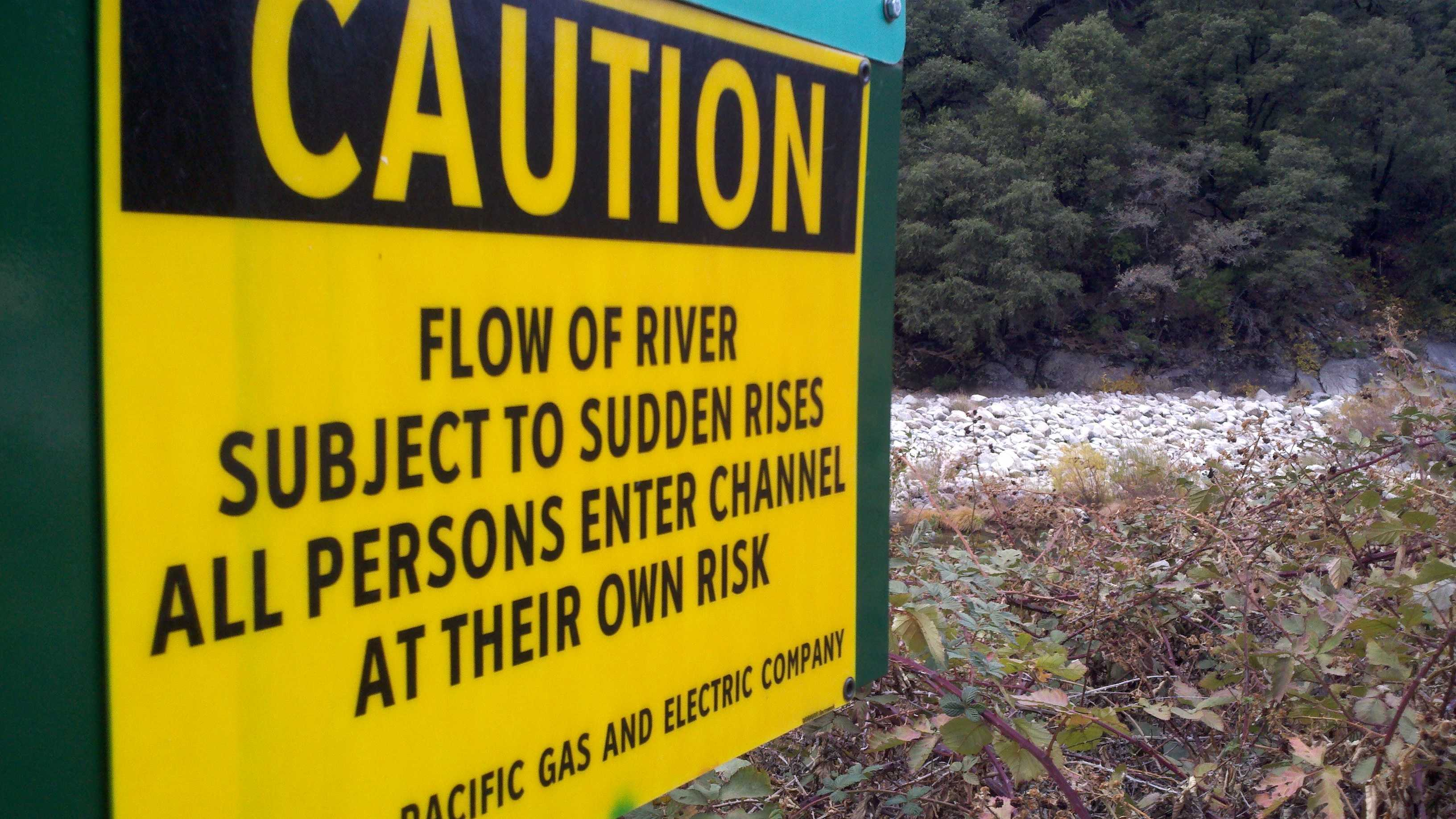 A sign along the Feather River warns of sudden water level changes.