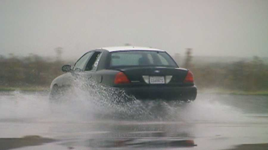 A California Highway Patrol driving instructor demonstrates how easily it is to fishtail on wet roads at slower than freeway speeds with worn tires.