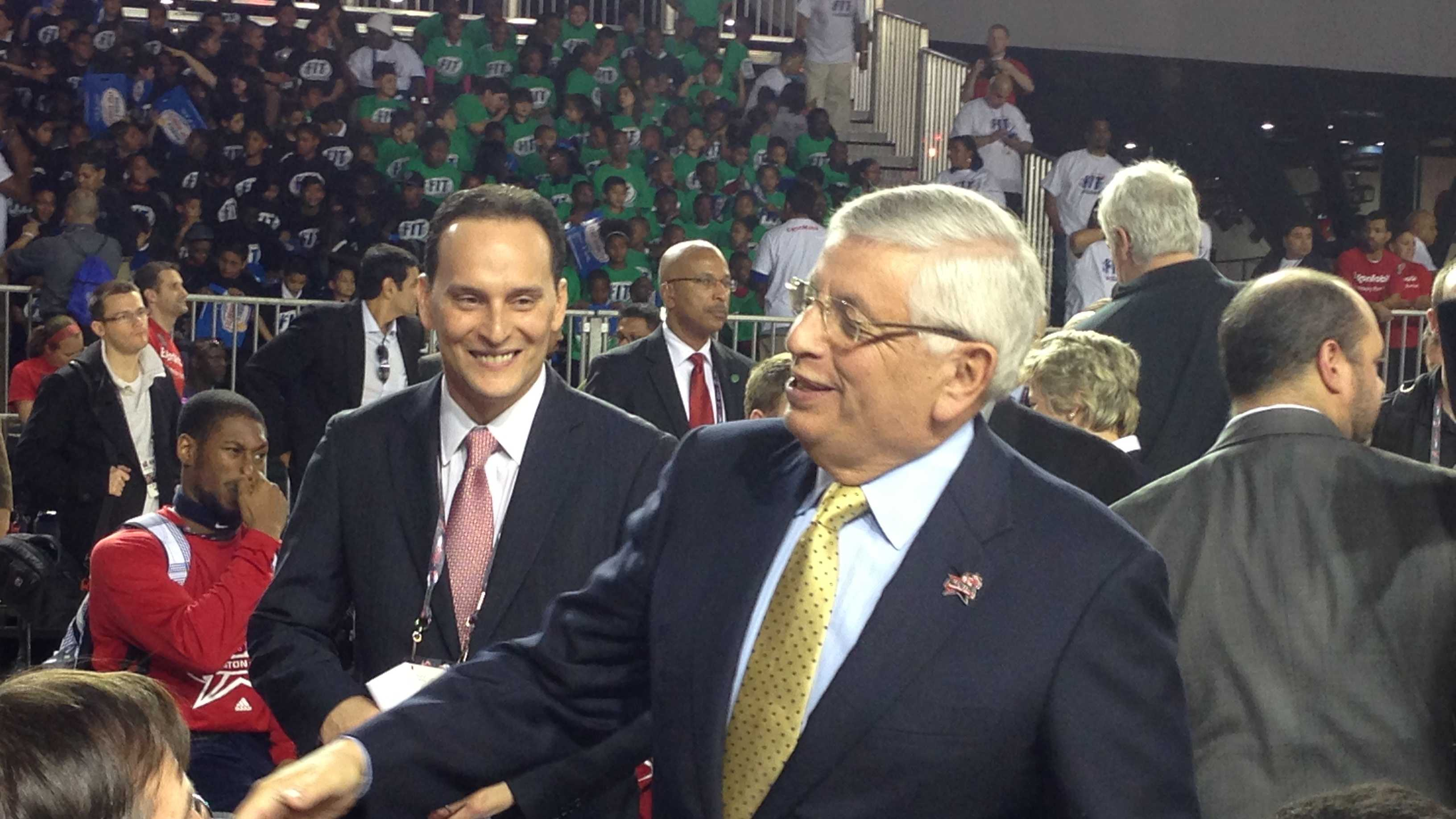 NBA Commissioner David Stern shakes fans hands Friday in Houston.