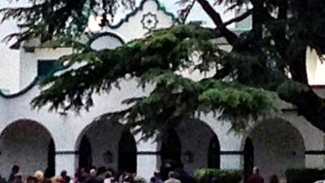 People gather for a private funeral service in Manteca for 8-year-old Leila Fowler.