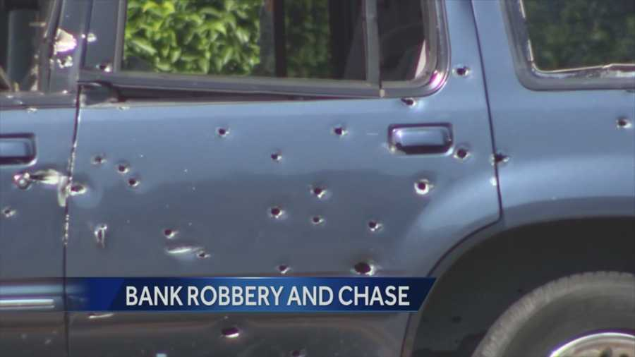 Cars and houses were riddled with bullets during a high-speed chase and hostages were thrown from a fleeing SUV after a bank robbery Wednesday that led to the deaths of a hostage and two robbers, police said.