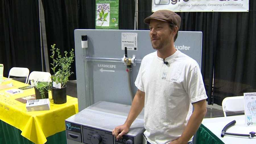 Chris Lopez of Growwater stands in front of his display at the California State Home and Garden Show.