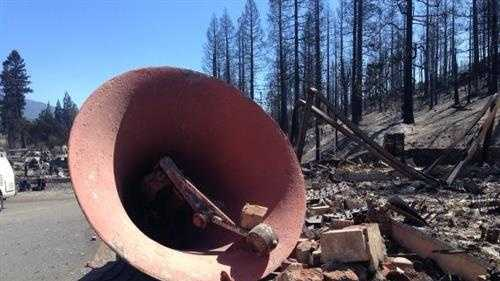 A church bell at the Holy Family Catholic Church, which was destroyed in the devastating Weed fire.