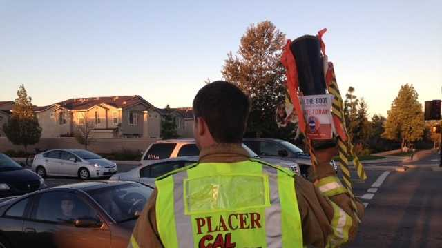 Cal Fire's Placer County firefighters seek donations for MDA at the intersection of Joiner Parkway and Ferrari Ranch Road Friday morning.