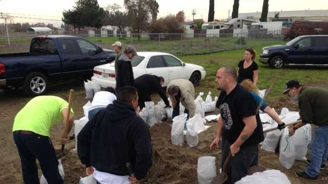 People fill sandbags Tuesday at a fire station in North Highlands.