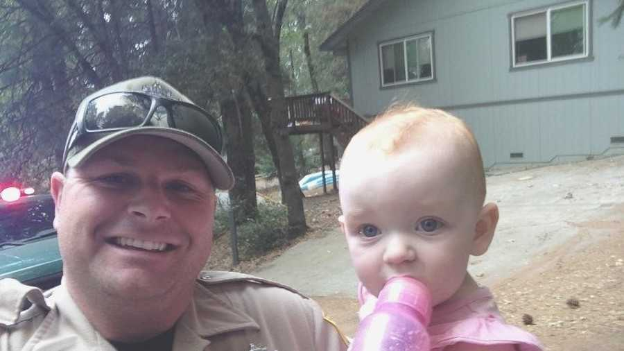 Timothy Little, a warden with the California Department of Fish and Wildlife, is credited with saving a baby and two women as the Valley Fire swept through towns.