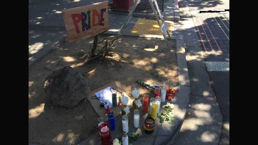 """Pride we stand together"" written at the growing memorial at 20th and K in midtown Sacramento."