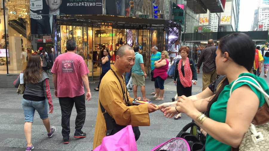 New York's popular tourist attractions are fakes, posing as monks to trick people into giving up their money.