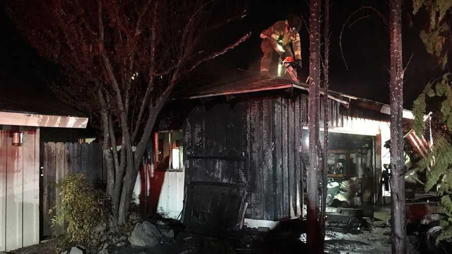 Firefighters extinguish flames at Carmichael home on Monday, July 4, 2016. The fire was caused by fireworks left in a bucket, the Sacramento Metro Fire Department said.