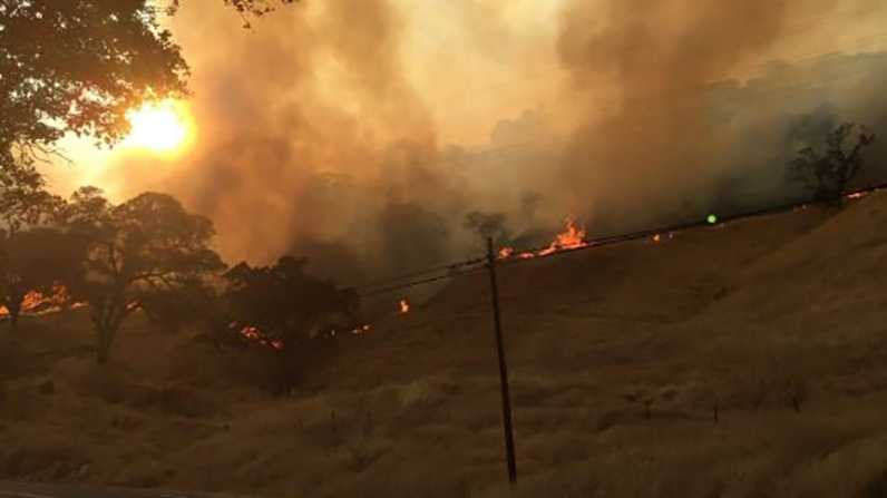 Flames burn on the hillside in Winters, Calif. on Tuesday, Aug. 2, 2016. The Cold Fire burned 600 acres along Highway 128 within 4 hours