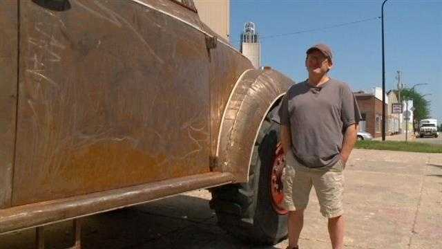 Two Iowans build a massive VW Bug that stands about 9 feet tall.