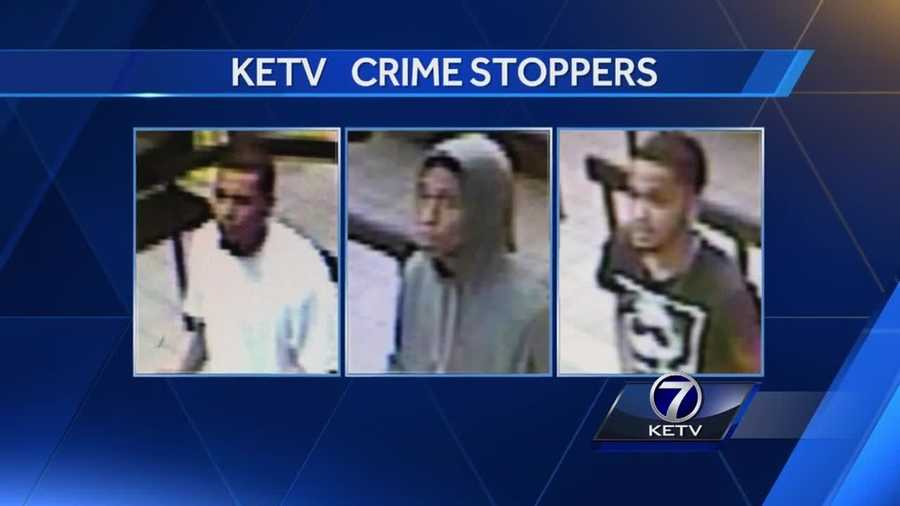 Omaha police have released new pictures of three men they want to question about a bank robbery.