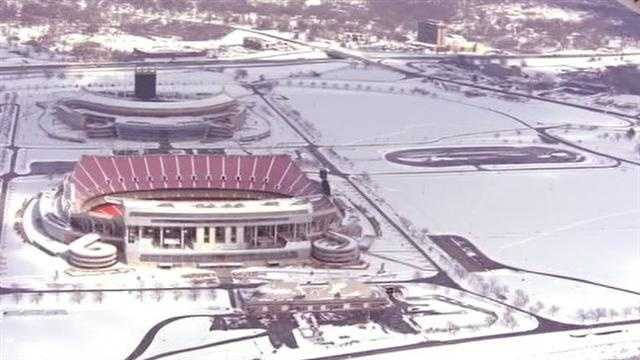 A snowy Kauffman Stadium and Arrowhead Stadium.