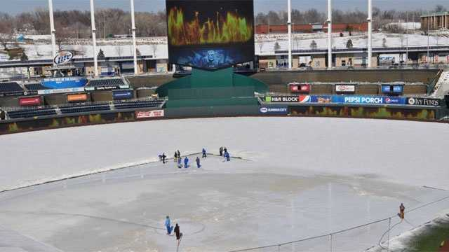 In a picture tweeted by the Kansas City Royals, the team's video board operator offers some warm images to help the snow removal process.
