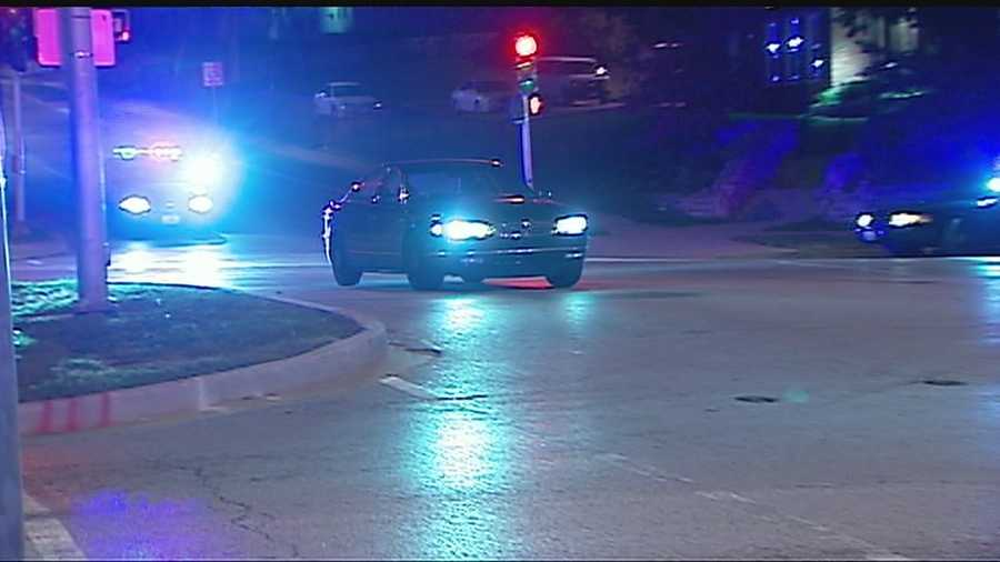 Police chased a driver past a homicide scene near 59th Street and Swope Parkway early Wednesday morning and it was all caught on camera.