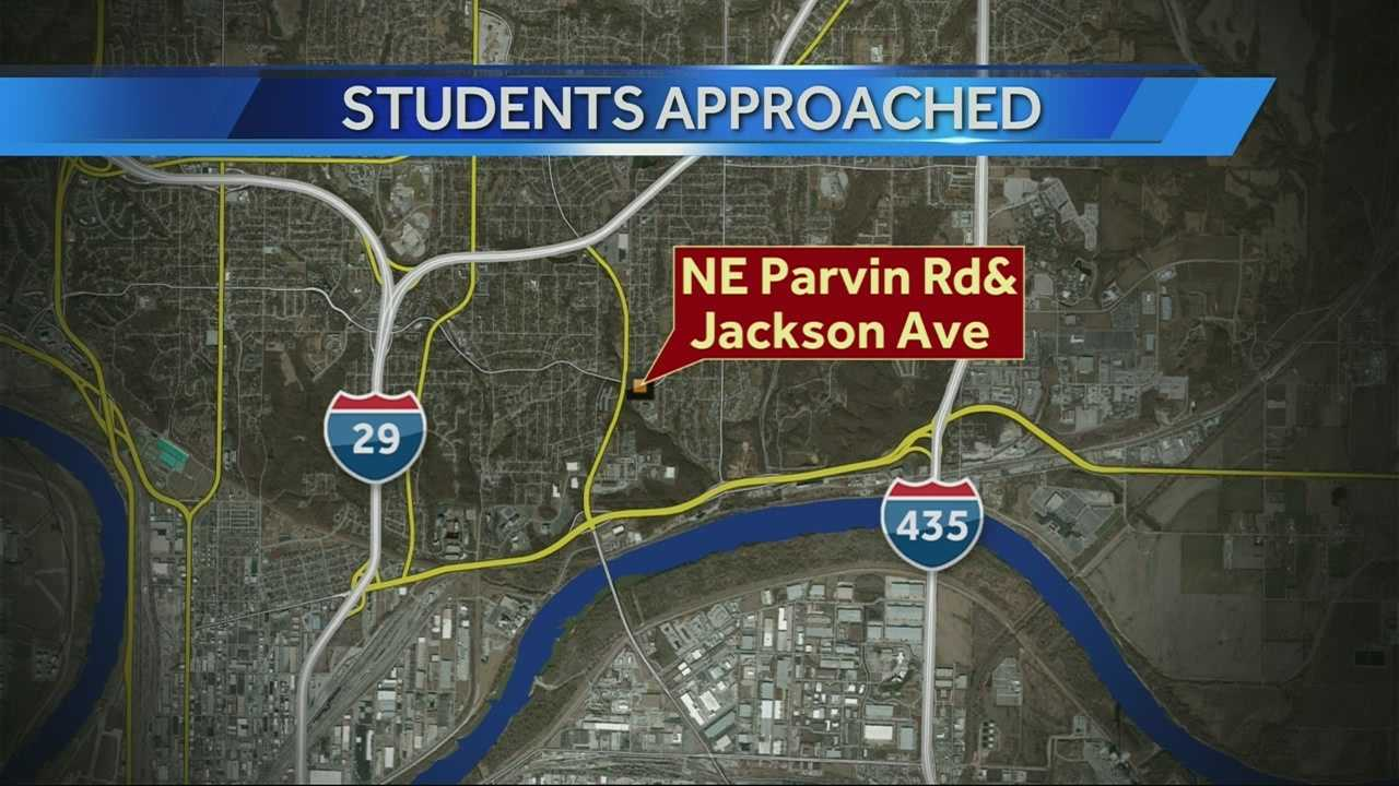 Two students at Chouteau Elementary School said a man and a woman pulled up to them in a car near Parvin Road and Jackson Avenue and the man tried to grab them.