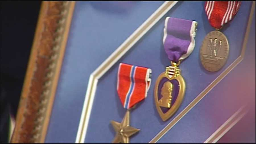 A Purple Heart and other military medals belonging to a Kansas soldier killed in World War II were returned to his family during a ceremony Saturday.