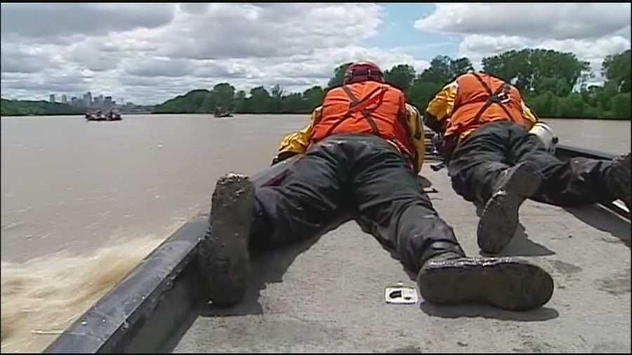 Kansas City firefighters who specialize in water rescues practiced their skills on the Missouri River on Thursday.