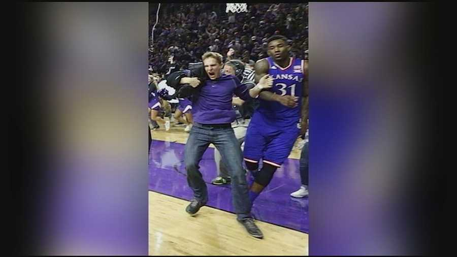 After a rush on the basketball court that exposed potential holes in security at Kansas State University, the school's athletic director has apologized.