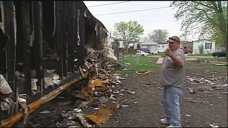 Weeks after fire swept through their mobile home in Claycomo, a family says they haven't been told what caused the fire and they can't afford to clean up and move the debris.
