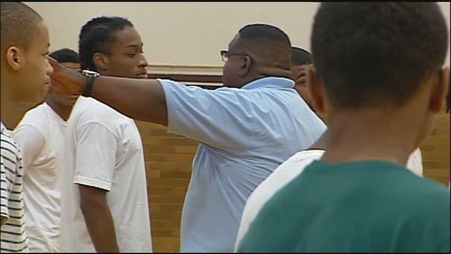 Kansas City's Urban Ranger Corps is providing high school-aged boys with lessons of discipline and teamwork as they spend the summer serving their city.
