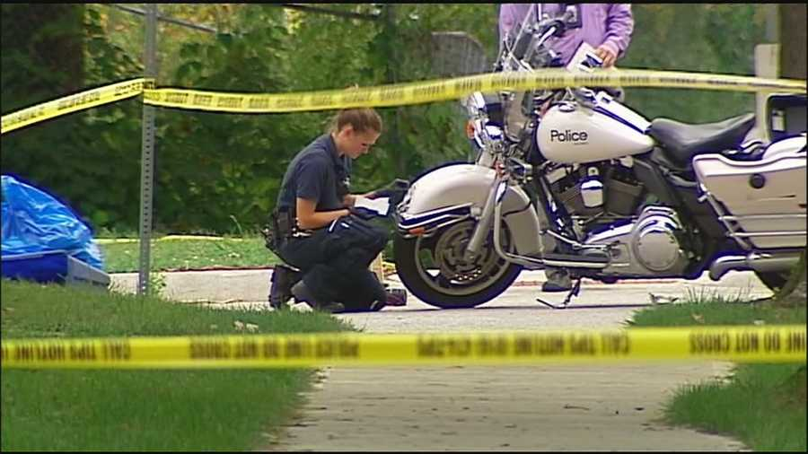A child was hit by gunfire after a police officer fired shots when his motorcycle was struck by a suspect vehicle on Friday morning.