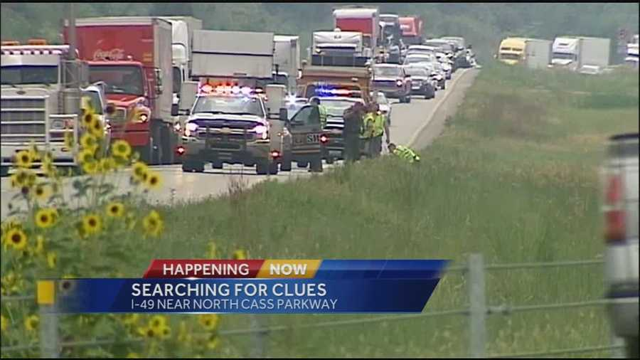 Police were searching an area along I-49 in Cass County on Tuesday following a highway shooting incident that injured 2 people.