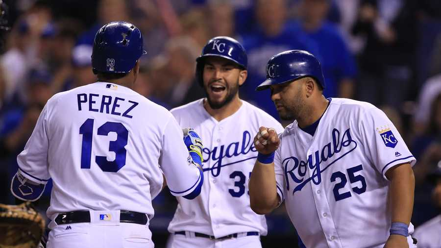 Kansas City Royals' Salvador Perez (13) is congratulated by teammates Kendrys Morales (25) and Eric Hosmer, back, after his three-run home run in the fifth inning of a baseball game against the Detroit Tigers at Kauffman Stadium in Kansas City, Mo., Tuesday, April 19, 2016. (AP Photo/Orlin Wagner)