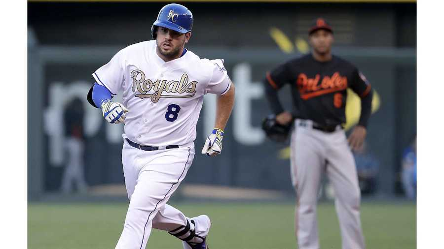 Kansas City Royals' Mike Moustakas (8) rounds the bases past Baltimore Orioles second baseman Jonathan Schoop after hitting a two-run home run during the first inning of a baseball game Friday, April 22, 2016, in Kansas City, Mo. (AP Photo/Charlie Riedel)
