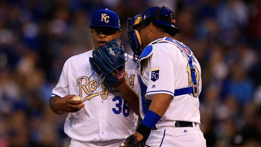 Kansas City Royals starting pitcher Edinson Volquez (36) and catcher Salvador Perez (13) of a baseball game at Kauffman Stadium in Kansas City, Mo., Friday, May 13, 2016. (AP Photo/Orlin Wagner)