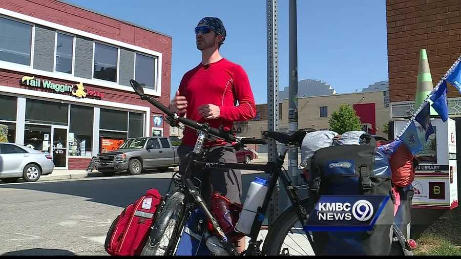 A man who is riding a bicycle through all 50 states stopped in Kansas City on Wednesday.