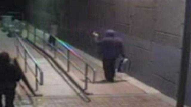 Criminals sprayed an entire wall at a rail runner station with graffiti. They even filmed themselves vandalizing the property on their smart phones. But what they didn't know was that a security camera caught them in the act as well.