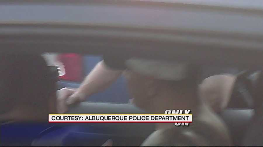 An Albuquerque firefighter was caught on camera using some colorful language and threatening to kill officers after he was kicked out of an Isotopes game.