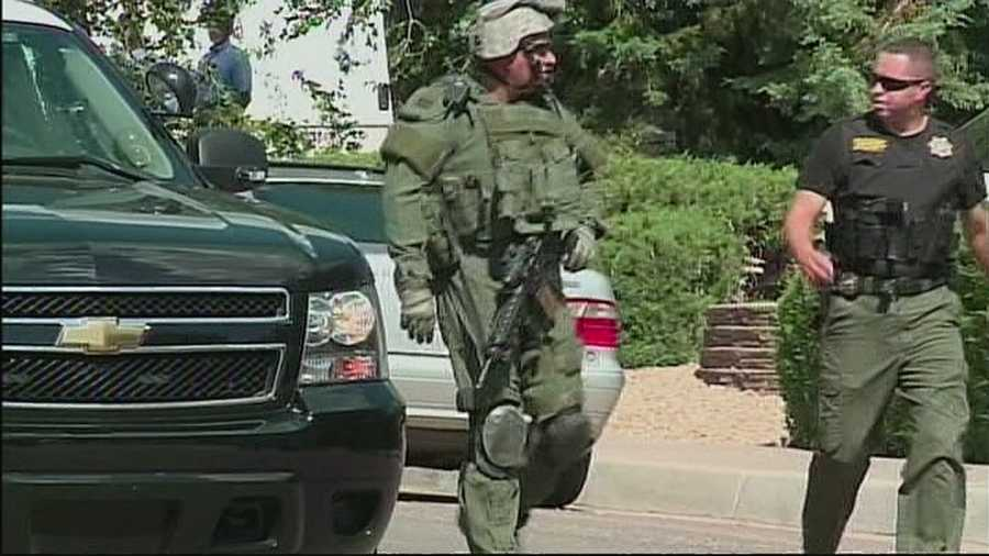 APD officers are negotiating with a man who has been barricaded inside a home for more than 5 hours.  A massive police presence in northeast Albuquerque