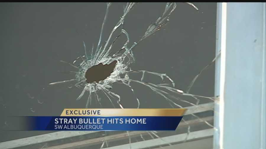 A stray bullet from Monday's deadly officer involved shooting hit a nearby mobile home, and the woman inside says it gave her a pretty big scare