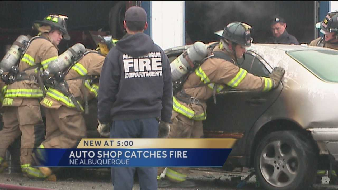 A car is a total loss and an auto repair business was evacuated after a fire started inside the shop.