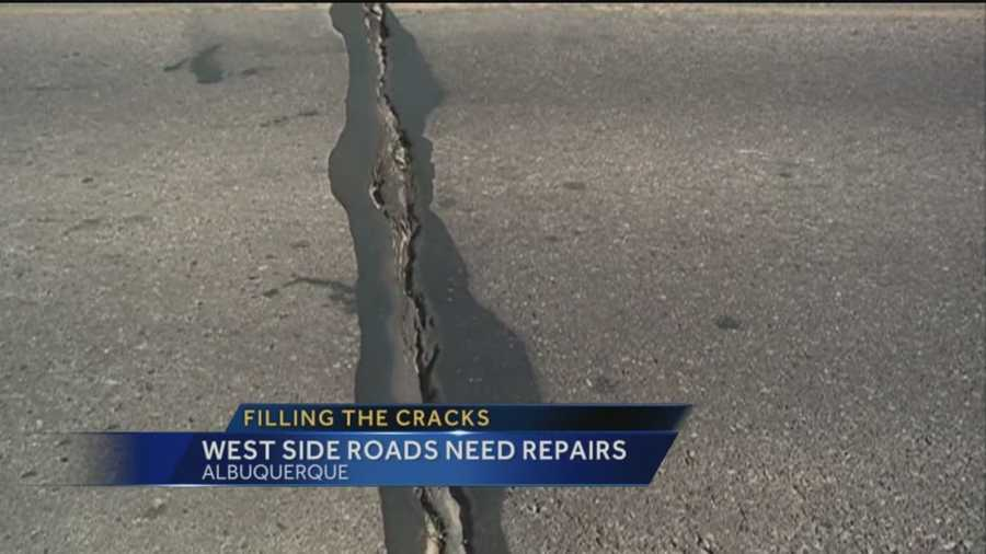 Many of Albuquerque's roads west of the Rio Grande are cracking, with some cracks splitting a foot wide.