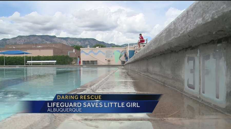 A city of Albuquerque lifeguard was hailed a hero Tuesday after saving a little girl from drowning.