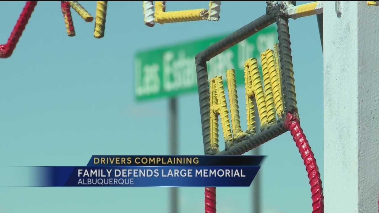 The New Mexico Department of Transportation is reviewing whether to remove a massive roadside memorial along Coors Boulevard dedicated to a popular boxer killed in a car crash.