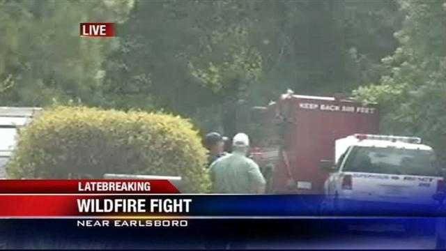 Firefighters are battling a wildfire in Earlsboro Friday morning.