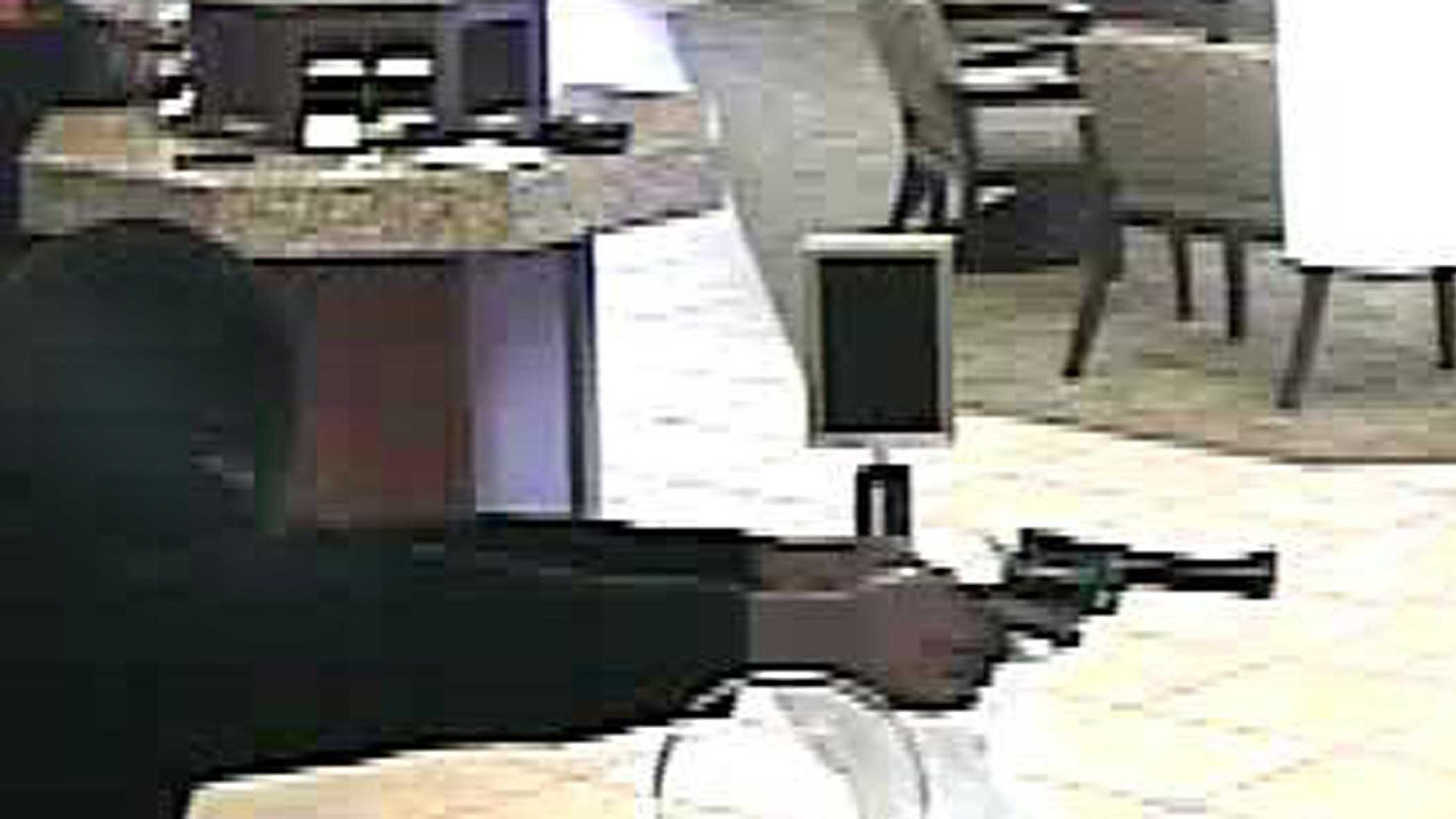Authorities say two men robbed the BancFirst in Del City Saturday morning.
