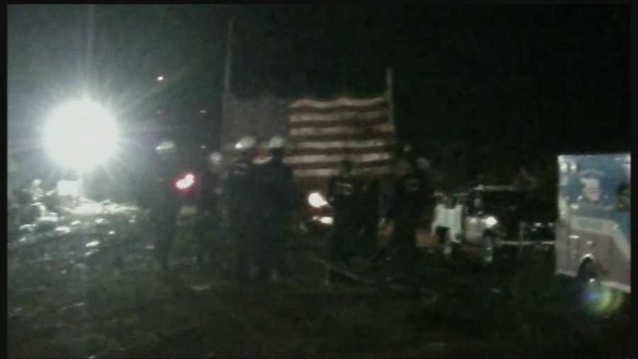 A battered American flag, found in the rubble of Plaza Towers Elementary, now hangs over the site as a show of respect for the victims and a country in mourning.