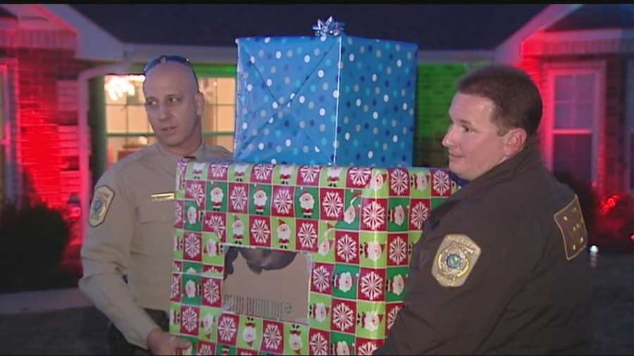 Pottawatomie County deputies and their families decided to share their Christmas by given their presents to a family whose home and possessions were lost in a fire.