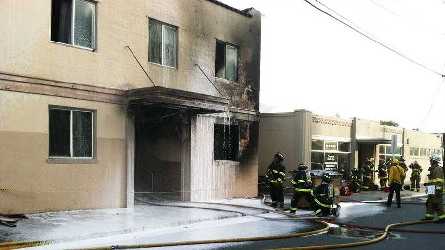 Firefighters douse the Stag Hotel in Watsonville. (April 30, 2012)