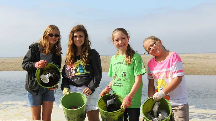 Four girls were all smiles after collecting trash at Rio Del Mar Beach in Aptos with Share Our Shores. (July 5, 2013)