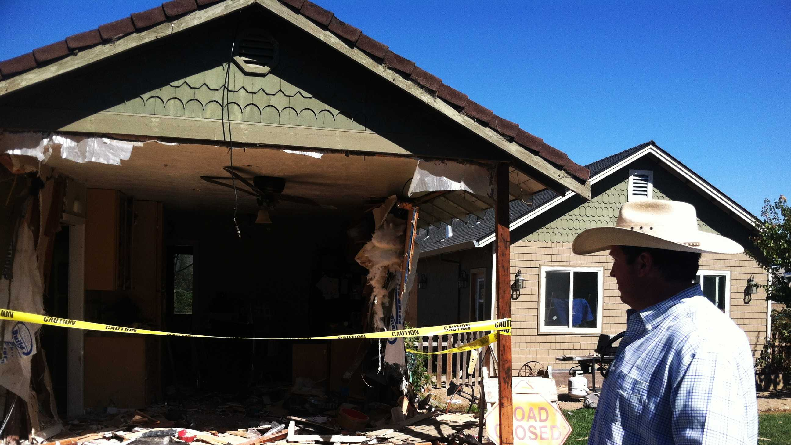 Hollister Police Chief David Westrick looks at his heavily damaged house. (Oct. 4, 2013)