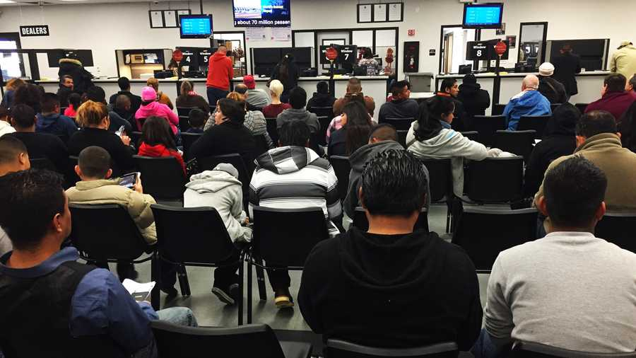 People wait in a DMV office in Salinas on Friday.  Jan. 2, 2014